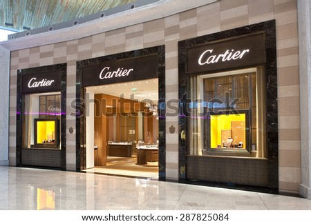 PARIS, FRANCE - NOVEMBER 12, 2014: Cartier store at the Paris Charles de Gaulle Airport. Cartier is a company founded in France in 1847. It operates more than 200 stores in 125 countries
