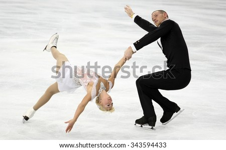 PARIS, FRANCE - NOVEMBER 16, 2013: Caydee DENNEY / John COUGHLIN of USA perform free program at Trophee Bompard ISU Grand Prix at Palais Omnisports de Bercy.
