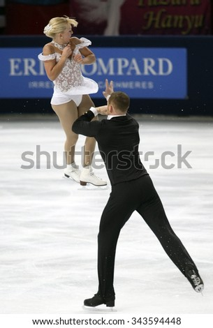 PARIS, FRANCE - NOVEMBER 16, 2013: Caydee DENNEY / John COUGHLIN of USA perform free program at Trophee Bompard ISU Grand Prix at Palais Omnisports de Bercy. - stock photo
