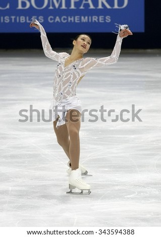 PARIS, FRANCE - NOVEMBER 16, 2013: Christina GAO of USA performs free program at Trophee Bompard ISU Grand Prix at Palais Omnisports de Bercy. - stock photo