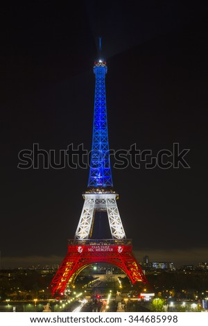 PARIS, FRANCE - NOVEMBER 19: Eiffel tower illuminated with colors of the French national flag after terrorist attack, 2015 in Paris - stock photo