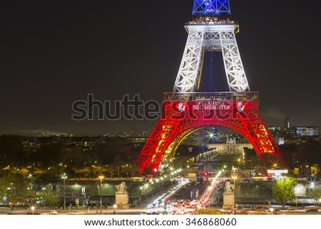 PARIS, FRANCE - NOVEMBER 19: Eiffel tower illuminated with colors of the French national flag after terrorist attack, 2015 in Paris