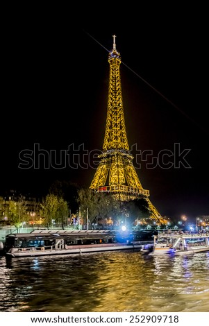 PARIS, FRANCE - NOVEMBER 11, 2014: Eiffel Tower (La Tour Eiffel) at night. Eiffel Tower is tallest structure in Paris and most visited monument in the world.