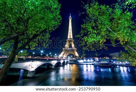 Paris, France - November 19, 2014: Eiffel tower, Paris night cityscape with light show - stock photo