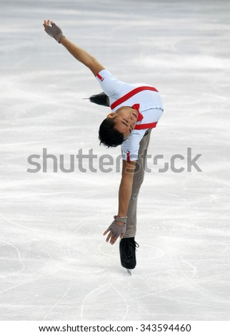 PARIS, FRANCE - NOVEMBER 16, 2013: Florent AMODIO of France performs free program at Trophee Bompard ISU Grand Prix at Palais Omnisports de Bercy. - stock photo