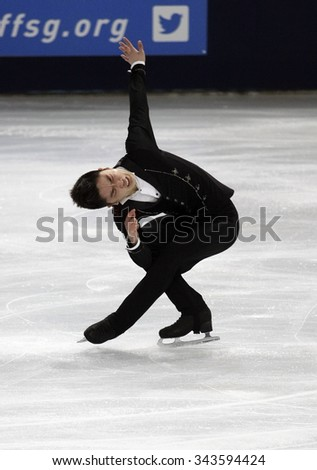 PARIS, FRANCE - NOVEMBER 16, 2013: Han YAN of China performs free program at Trophee Bompard ISU Grand Prix at Palais Omnisports de Bercy. - stock photo