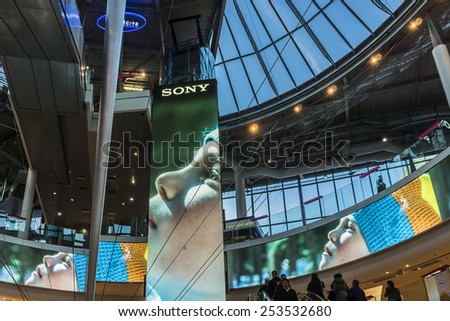 "PARIS, FRANCE - NOVEMBER 12, 2014: Interior of shopping mall ""Four Seasons"" near Arche de la Defense, Paris. It has many retail shops as well as cafes and restaurants."