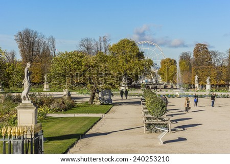 PARIS, FRANCE - NOVEMBER 12, 2014: Jardin des Tuileries (Tuileries garden) - favorite spot for rest of tourists and Parisians. Garden was created by Catherine de Medici in 1564.  - stock photo