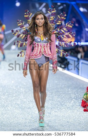 PARIS, FRANCE - NOVEMBER 30: Jasmine Tookes walks the runway at the Victoria's Secret Fashion Show on November 30, 2016 in Paris, France.