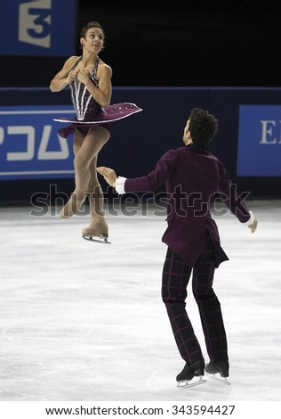 PARIS, FRANCE - NOVEMBER 16, 2013: Meagan DUHAMEL / Eric RADFORD of Canada perform free program at Trophee Bompard ISU Grand Prix at Palais Omnisports de Bercy.
