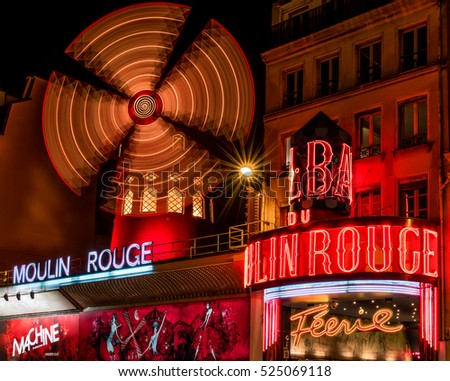 Paris, France - November 25, 2015 - Moulin Rouge at night. World famous nightclub and tourist attraction.