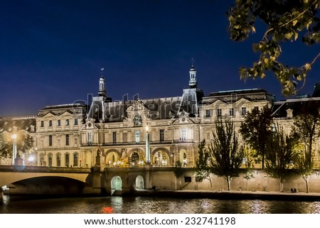 PARIS, FRANCE - NOVEMBER 12, 2014: Night view of famous Louvre Museum from the Seine river. Louvre Museum is one of the largest and most visited museums worldwide.