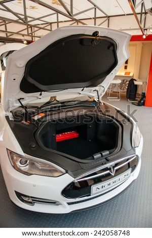 PARIS, FRANCE - NOVEMBER 29, 2014: Open front trunk of a Tesla car at showroom in Paris, France. Tesla is an American company that designs, manufactures, and sells electric cars - stock photo