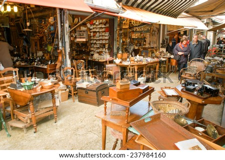 Paris, France - 3 November 2002: People shopping at the flea market of Clignancourt at Paris on France - stock photo