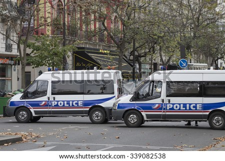 PARIS, FRANCE - NOVEMBER 14, 2015 : Police in front of the theater Bataclan to protect crime scene after terrorist attack of ISIS at Paris november 13, 2015. - stock photo