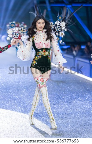 PARIS, FRANCE - NOVEMBER 30: Sui He walks the runway at the Victoria's Secret Fashion Show on November 30, 2016 in Paris, France.