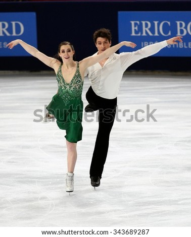 PARIS, FRANCE - NOVEMBER 16, 2013: Tessa VIRTUE / Scott MOIR of Canada perform free dance at Trophee Bompard ISU Grand Prix at Palais Omnisports de Bercy.