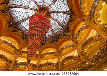 Paris, France - November 26, 2014: The Galeries Lafayette with the Christmas decorations and the particular tree toppled. The special Christmas Tree is the largest indoor world. - stock photo
