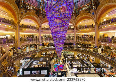 Paris, France - November 26, 2014: The Galeries Lafayette with the Christmas decorations and the upside down tree. The special Christmas Tree is the largest indoor world. - stock photo