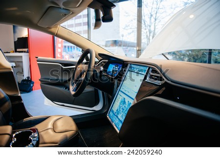 PARIS, FRANCE - NOVEMBER 29, 2014: The interior of a Tesla Motors Inc. Model S electric vehicle with its large touchscreen dashboard. - stock photo