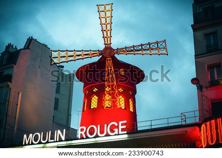 PARIS, FRANCE - 16 NOVEMBER, 2014: The Moulin Rouge by night. Moulin Rouge is a famous cabaret built in 1889, located in the Paris red-light district of Pigalle, on November 16, 2014 in Paris, France.
