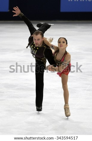 PARIS, FRANCE - NOVEMBER 16, 2013: Vera BAZAROVA / Yuri LARIONOV of Russia perform free program at Trophee Bompard ISU Grand Prix at Palais Omnisports de Bercy.