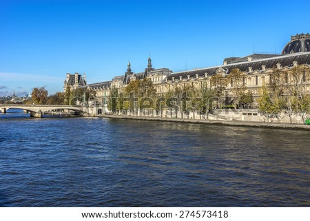 PARIS, FRANCE - NOVEMBER 12, 2014: View of famous Louvre Museum from the Seine river. Louvre Museum is one of the largest and most visited museums worldwide.