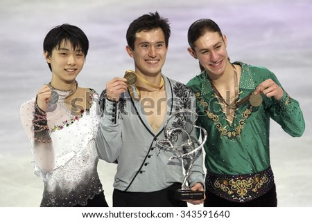 PARIS, FRANCE - NOVEMBER 16, 2013: Yuzuru HANYU (L), Patrick CHAN, Jason BROWN  pose during the victory ceremony at Trophee Bompard ISU Grand Prix at Palais Omnisports de Bercy. - stock photo