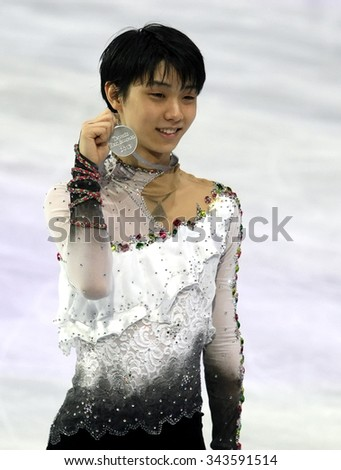 PARIS, FRANCE - NOVEMBER 16, 2013: Yuzuru HANYU of Japan poses during the victory ceremony at Trophee Bompard ISU Grand Prix at Palais Omnisports de Bercy. - stock photo