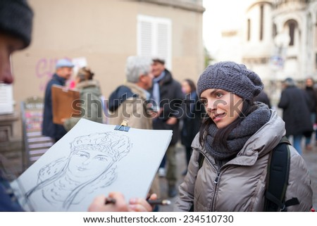 PARIS, FRANCE - Novenber 24, 2014: Artists sell paintings in front of cafes at the Place du Tertre Paris Montmartre Paris,France.