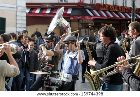PARIS, FRANCE - OCT. 13: Group of young musicians as seen on Montmartre in Paris on October 13, 2013 in Paris, France. Dozens buskers perform on the streets and in metro of Paris. - stock photo