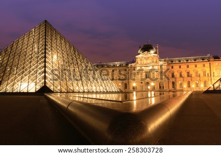 PARIS, FRANCE - OCT 13, 2011: Louvre Museum at night on October 13, 2011 in Paris, France. It is the most visited museum in France and a UNESCO world heritage. - stock photo