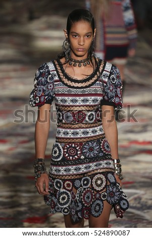 PARIS, FRANCE - OCTOBER 3: A model walks the runway during the Alexander McQueen designed by Sarah Burton show as part of the PFW Womenswear SS2017 on October 3, 2016 in Paris, France