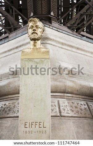 PARIS, FRANCE - OCTOBER 8, 2011: Bust of Gustave Eiffel in front of the Eiffel Tower on October 8, 2011 in Paris, France. Gustave Eiffel is the architect who designed the famous Eiffel Tower. - stock photo