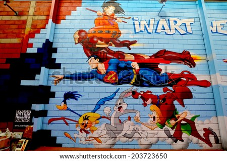 PARIS FRANCE OCTOBER 12: Cartoon street art superheroes in Paris France october 12 2013. - stock photo