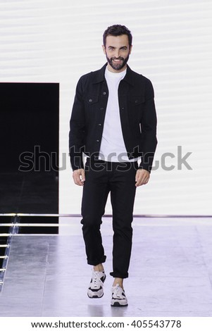 PARIS, FRANCE - OCTOBER 07: Designer Nicolas Ghesquiere walks the runway during the Louis Vuitton show as part of the Paris Fashion Week Spring/Summer 2016 on October 07, 2015 in Paris, France. - stock photo