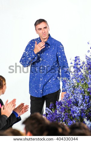 PARIS, FRANCE - OCTOBER 02: Designer Raf Simons walks the runway during the Christian Dior show as part of the Paris Fashion Week Womenswear Spring/Summer 2016 on October 2, 2015 in Paris, France. - stock photo