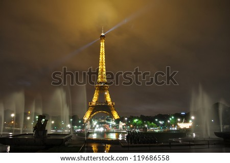 PARIS, FRANCE - OCTOBER 5: Eiffel tower at night. Three hundred workers joined together 18,038 pieces of puddled iron, using two and a half million rivets. October 5, 2010 in Paris - stock photo