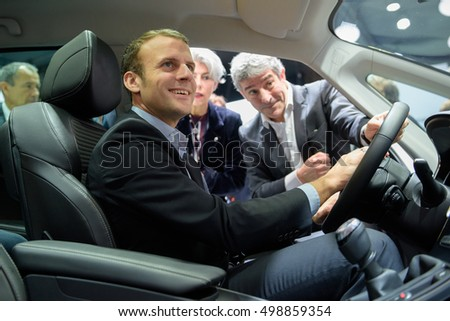 PARIS, FRANCE - OCTOBER 15, 2016 : Emmanuel Macron inside a Renault Espace (Renault Nissan group )at the Paris Motor Show 2016.