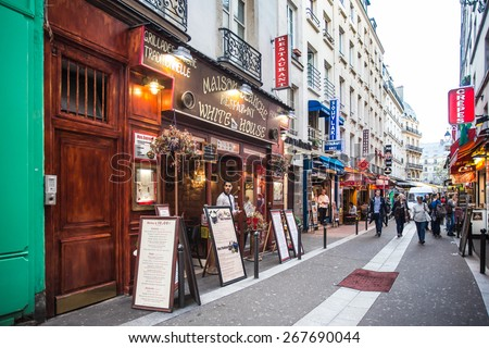 PARIS, FRANCE - OCTOBER 9, 2014: Image of street scene from the Latin Quarter on the left bank of Paris France  - stock photo