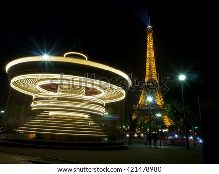 Paris, France October 20, 2015: in a long exposure of the carousel at the Eiffel tower, warm autumn evening