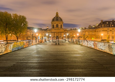 Paris, France. October 17, 2015: Institut de France and the Pont des Arts or Passerelle des Arts bridge across river Seine. HDR Shot - stock photo