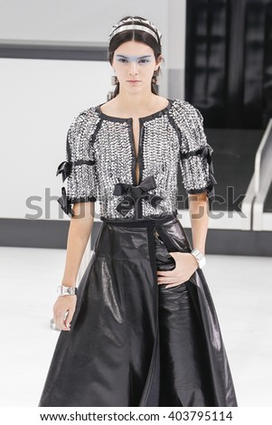 PARIS, FRANCE - OCTOBER 06: Kendall Jenner walks the runway during the Chanel show as part of the Paris Fashion Week Womenswear Spring/Summer 2016 on October 6, 2015 in Paris, France. - stock photo