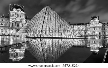 Paris, France - October 15 : Louvre museum and Pyramid at night on October 15,2010. Louvre is the biggest Museum in Paris displayed over 60,000 square meters of exhibition space. - stock photo