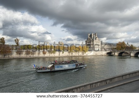 PARIS, FRANCE - October 2015: Modern transport boat on Senna in autumn. Paris - Only Editorial Use