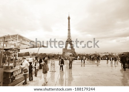 PARIS, FRANCE - OCTOBER 7: Parisians and tourists around Eiffel tower viewpoint on October 7, 2011. Tourists strolling around famous French landmark - stock photo