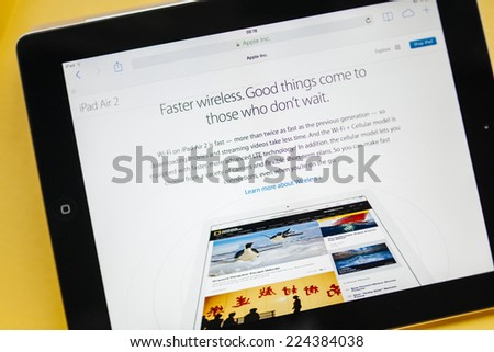 PARIS, FRANCE - 17 OCTOBER 2014: Photo of Apple iPad tablet with apple.com webpage of new iPad Air 2 &iPad Mini 3 faster wireless specs. Apple unveiled the new iMac iPad Air 2 &iPad Mini 3 on 16 Oct - stock photo