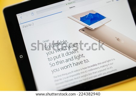 PARIS, FRANCE - 17 OCTOBER 2014: Photo of Apple iPad tablet with apple.com webpage of the new iPad Air 2 & iPad Mini 3 gold color body. Apple unveiled the new iMac iPad Air 2 and iPad Mini 3 on 16 Oct - stock photo