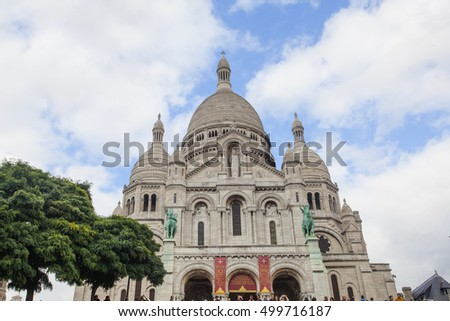 PARIS, FRANCE - OCTOBER 1: Sacre Coeur Basilica in summer day. Large medieval cathedral. Basilica of Sacred Heart. Popular landmark, highest city point.  October 1, 2016, Paris, France, Europe.