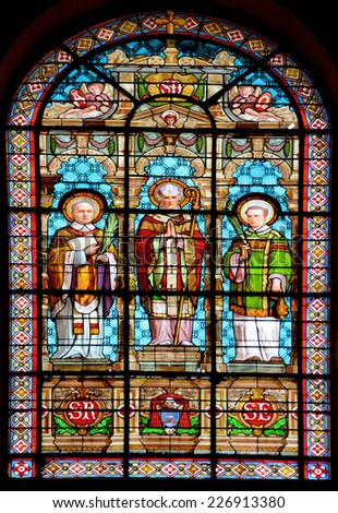 PARIS, FRANCE - OCTOBER 19: Stained glass window in Church of Saint-Roch  is a late Baroque church in Paris, dedicated to Saint Roch in Paris, France, on october 19, 2014 - stock photo